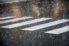 Pedestrian crossing during the big rainstorm Stock Photos