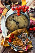 Old clock on the background of fallen leaves Stock Photos