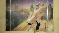 Pole dancer girl training in private gymnasium Stock Footage