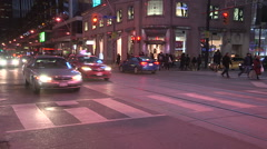 Toronto at night with people skating under colorful LED lights Stock Footage