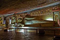 buddah and painting in the famous rock tempel of dambullah, sri lanka - stock photo