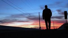 Silhouette of man walking closer Stock Footage
