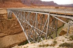 old navajo bridge spanning the  colorado at marble canyon - stock photo
