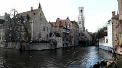 Popular canal area in Bruges, Belgium. Belfry visible. Sound of bells & tourists Stock Footage