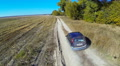 Rural Road With Car. HD Footage