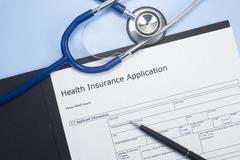 health insurance application - stock photo