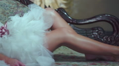 beautiful model with great legs on lounge posing - stock footage
