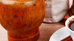 Black turkish coffee served with accesories on wooden table Stock Footage