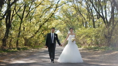 Bride and groom enjoy each other on the nice location Stock Footage