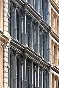 Facade at old houses downtown in new york Stock Photos