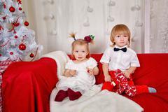 brother and sister awaiting christmas - stock photo