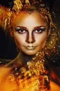 Woman with golden make-up Stock Photos