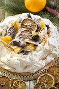 pavlova with spicy cream with christmas decor. - stock photo