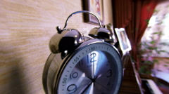 The alarm clock rings. Dolly shot. Shallow depth of field. Close up Stock Footage