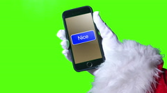 4K Santa Pushes Nice Button on Smartphone Stock Footage