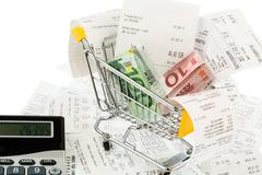 Stock Photo of shopping cart, receipts and money