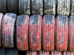 Stack of worn car tires Stock Photos