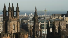 4K Cityscape with Scott Monument and Amusement Park in Edinburgh, Scotland Stock Footage