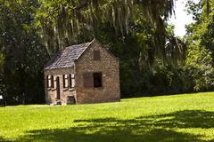 old slave huts in a south carolina farm - stock photo