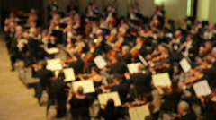 Stock Video Footage of Philharmonic orchestra performs a concert (out of focus)