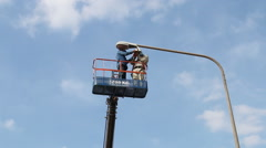 Technician to repair street lighting Stock Footage