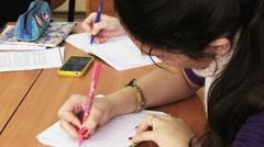 Shool Lesson, Girl writing on the paper Stock Footage