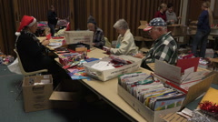 Dec volunteers men women open Christmas cards HD 022 Stock Footage