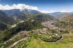 Banos De Agua Santa Aerial Shot From Nne Pastaza River In The Foreground And Stock Photos