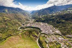 East Side Of Banos De Agua Santa High Altitude Wide Angle Helicopter Shot - stock photo
