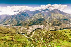 Aerial Shot Of Banos De Agua Santa Nne To Ssw Tungurahua Volcano In The Stock Photos