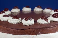 retail chocolate cake with whipped cream. - stock photo