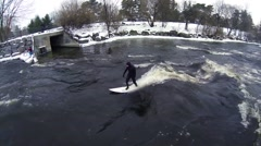 Winter River Surfing - Urban Sports - Surfer Falls in Water Stock Footage