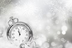 vintageclock with fireworks and holiday lights - stock photo