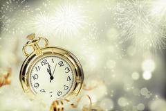 Vintageclock with fireworks and holiday lights Stock Photos