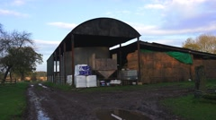 Farming old barn with bales of straw Arkistovideo