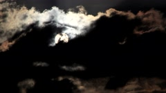 Timelapse telephoto clip of the sun appearing behind clouds Stock Footage