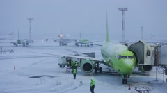Snowstorm at the airport. Preparation of aircraft for flight Stock Footage