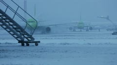 Snowstorm at the airport. Preparation protective treatment of aircraft icing Stock Footage
