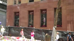 Lindt Cafe exterior with mourners Stock Footage