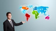 young man presenting colorful world map - stock photo