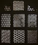 Beautiful carved window with oriental decor Stock Photos