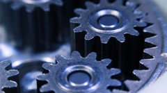 Movement of metal gears in a mechanical device - stock footage