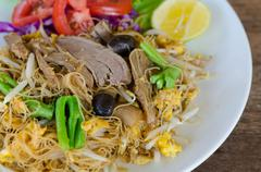thai style stir fried rice noodle with duck and vegetable - stock photo