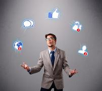 Handsome young boy juggling with social media icons Stock Photos