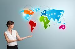Young woman presenting colorful world map Stock Photos