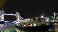 London, uk - dec 12 2014: golden flame cruise boat at night arriving at the p Stock Footage