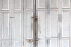 the retro style wood door with the key lock - stock photo