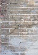 background with old rough antique brick wall terracotta brick with cracks and - stock photo