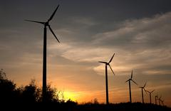Wind turbines in the sunset Stock Photos