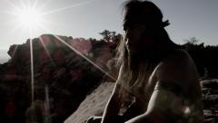 4K Native American looking up in the sunset Stock Footage